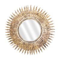 Miroir soleil doré avec rayons en plumes.