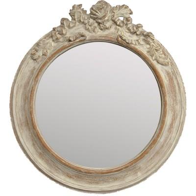 Miroir baroque de forme ronde et avec moulure.