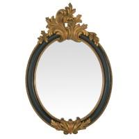 Miroir ancien style baroque avec son cadre noir orné de moulures dorées